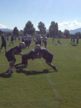 Montana State senior defensive end Preston Gale, right, engages with senior Brad Daly with sophomore Odin Coe in toe.
